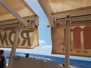 Gelenkarm Markise mit Windstützen